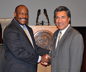 "Robert E. Criner, ""Mr. Enthusiasm!"", with Joe Munoz, Assistant to the President at Angelo State University."